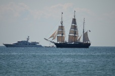 new and old technology with the big yacht next to the big whaler
