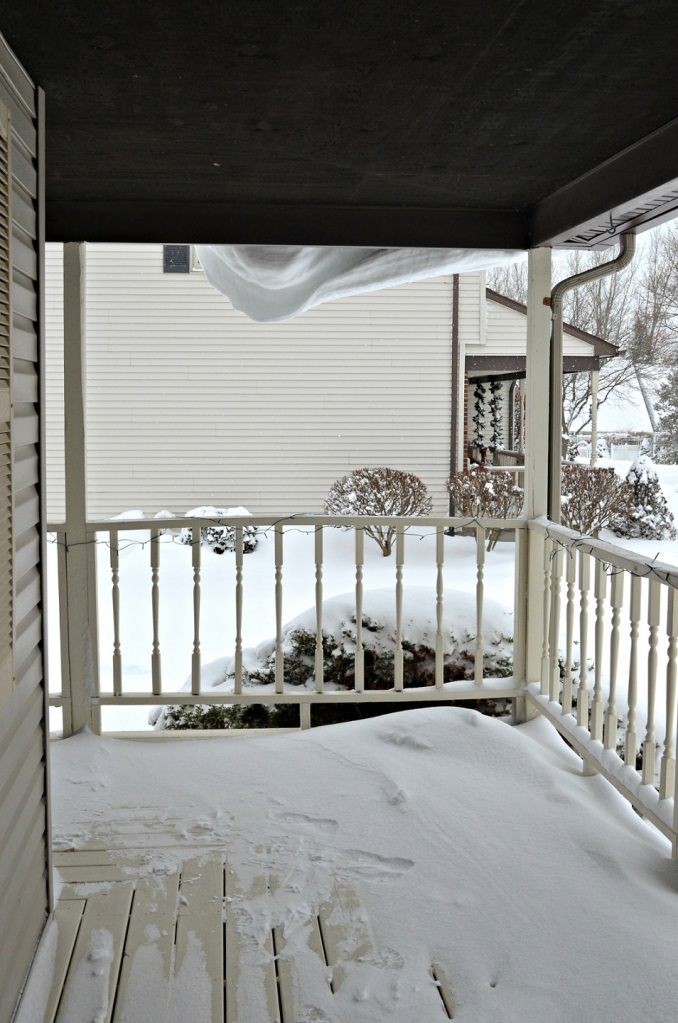 I saw this as I came up the stairs. I guess the snow blows over the edge of the porch roof.