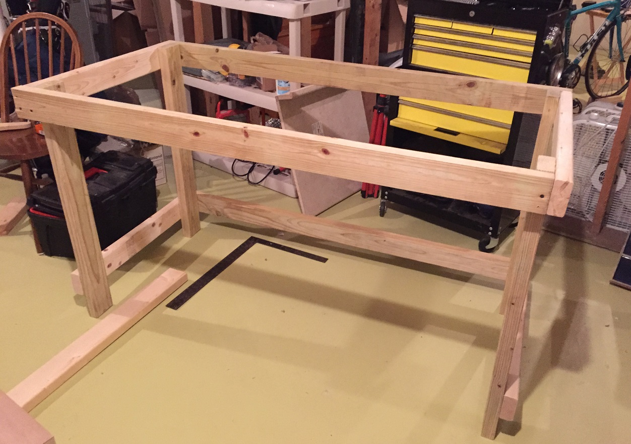 we placed the door on top of it and lined the back of the door up with the back of the frame we made the the overhang on both sides was equal - Workbench Frame